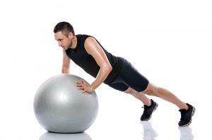 Man doing pilates ball