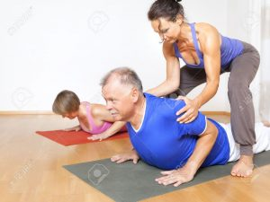 21774079-an-image-of-some-people-doing-yoga-exercises